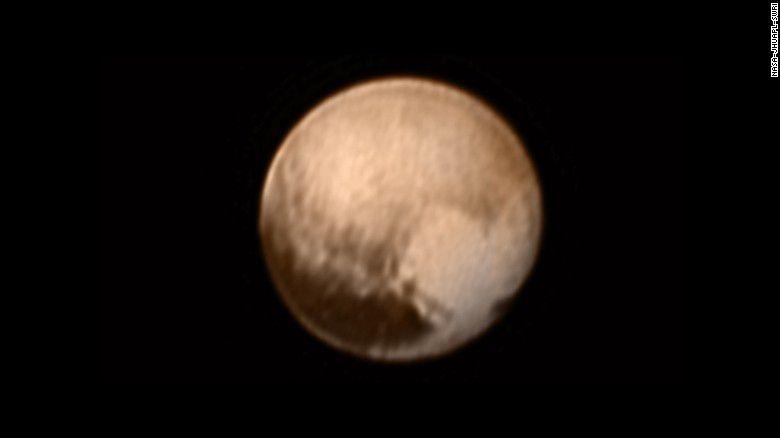 22 f150709114021-pluto-heart-exlarge-169