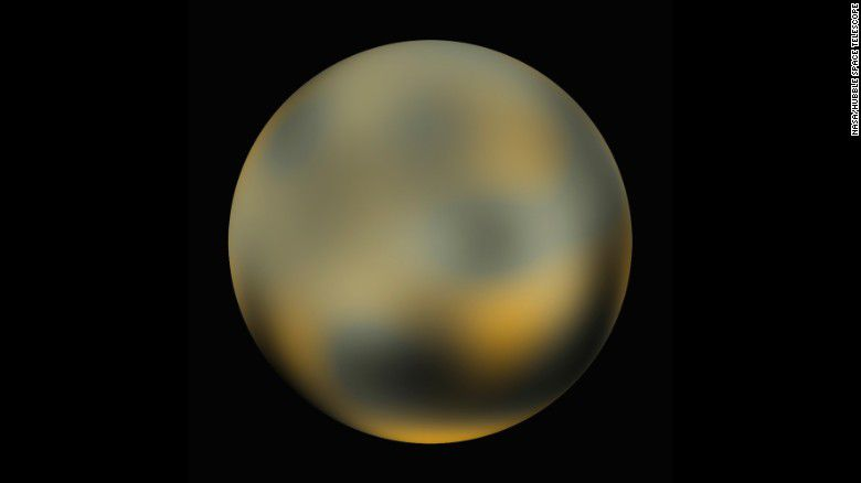 32 150125191446-pluto-from-hubble-2010-exlarge-169
